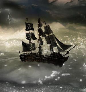 bateau de pirates surmonté de son terrifiant drapeau noir.