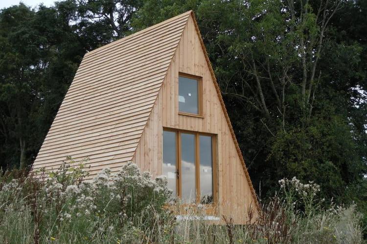 Le tipi en bois 10 maisons atypiques moins de 50 000 for Construction maison 60m2