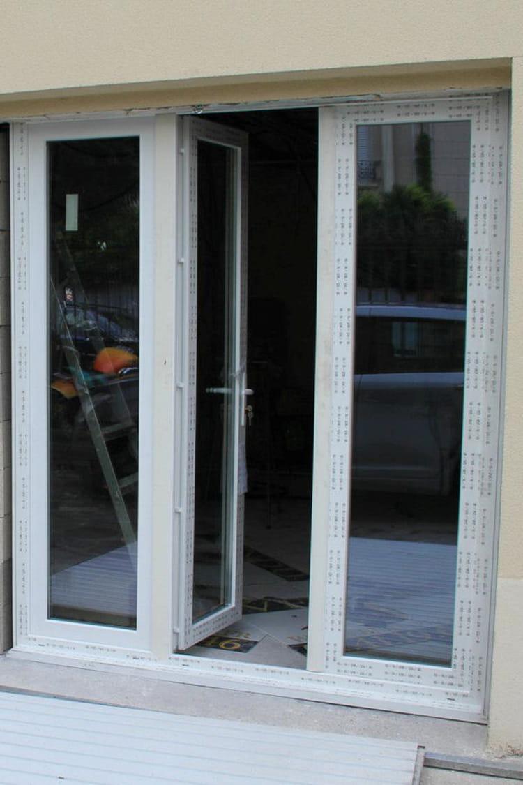 L 39 installation des portes fen tres deux garages for Installation porte fenetre
